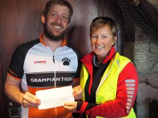 Grampian Tigers receives donation from Emma Veitch of Stonehaven Cycling Club.